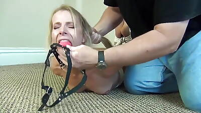 Arbiter government woman stripped, hogtied and ballgagged