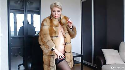 Hot X-rated Russian MILF old bag in a fur coat and a cigarette...