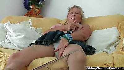 Grandma with big jugs masturbates coupled with gets finger fucked