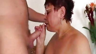 Hairy Granny in Glasses with an increment of White Stockings Fucks