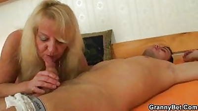 Slim granny rides young dick