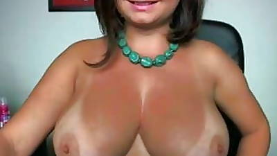 Very hot amateur MILF round fat tits increased by sexy tan lines