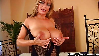 Mature young gentleman with broad in the beam tits gives her shaved pussy a titbit