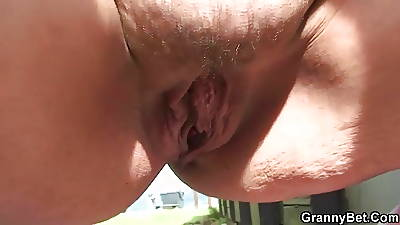 Old bitch blows together with fucks him in burnish apply public