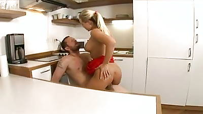 Blonde housewife in red sucks and gets fucked hard by get under one\'s plumber in get under one\'s kitchen