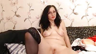curvy big pest milf in glasses strips heavens webcam