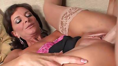 Erotic mature in stockings & heels takes a facial