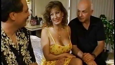 Horny married brunette sucks on three hard cocks at once occasionally gets drilled