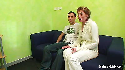 Granny watches porn before obtaining fucked unconnected with a younger guy