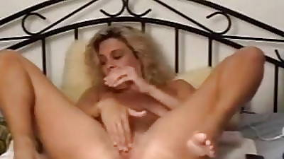 Dirty MILF slattern with huge dildo plus left-hand in her use up pussy