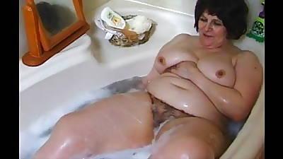 Beamy grandma in wash one\'s hands