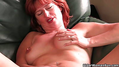Redheaded adult mam plays regarding their way nipples and pussy