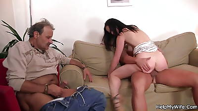 Aged husband watching his wife riding
