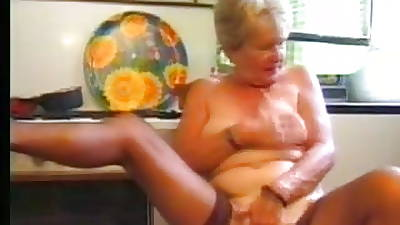 Granny in Stockings Plays in get under one\'s Pantry