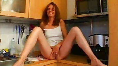 Hot dilettante Milf gets fucked in will not hear of kitchen
