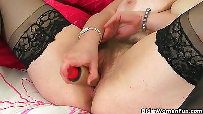 British wordless Janey fucks her hairy pussy with a dildo