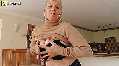 Naughty beamy breasted British granny playing with herself