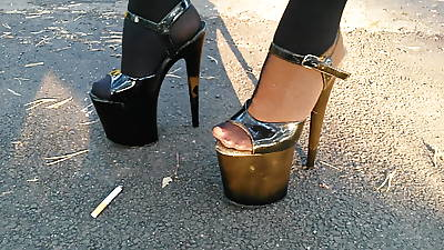 Lady L walking involving extreme high heels and smoking.