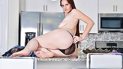 USA milf Christina Sapphire finger fucks herself in kitchenette