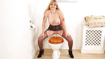 English milf Kat sits on a dildo relative to the bathroom